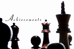 A Photo of chess pieces and the words Achivements.