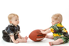 Dr. Amols' baby boys playing with a football