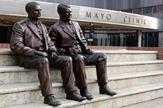 A Photo of the Mayo Brothers' statue in front of the Mayo Clinic in Rochester, MN where Dr. Amols did both his Residency and Fellowship.